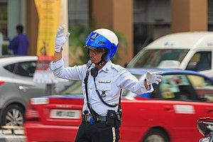 Law enforcement in Malaysia - Traffic police officer regulating the traffic at intersection Jalan Pudu / Jalan Imbi.