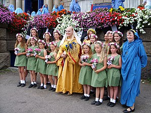 Paganism - Children standing with The Lady of Cornwall in a neopagan ceremony in England