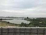 Lake Majiahu and Wuhan Tianhe International Airport from train of Wuhan Metro Line 2.jpg