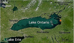 Satellite photograph of Lake Ontario. The cities of Syracuse, Rochester, Buffalo, and Toronto are labeled.