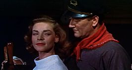 Lauren Bacall en John Wayne in Blood Alley