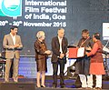 Laxmikant Parsekar presenting the ICFT –UNESCO Award to Kaushik Ganguly for 'CINEMAWALA', at the closing ceremony of the 46th International Film Festival of India (IFFI-2015), in Panaji.jpg