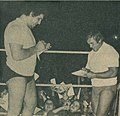 Le Géant Ferré signing Autographs with Édouard Carpentier - Wrestling Revue June 1973 page 14 - André the Giant - Unwanted by my family, I left home at fourteen (cropped).jpg