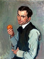 A man with an orange.