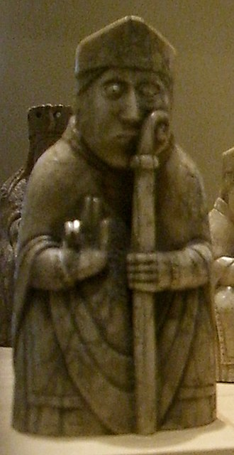 Dubgall mac Somairle - The pictured piece depicts a seated bishop, holding a crozier with two hands, and wearing a chasuble as an outer garment. The simple horned mitre worn by this particular piece may be evidence that it dates to the mid twelfth century, when horns began to be positioned on the front and back, as opposed to the sides of the headdress.