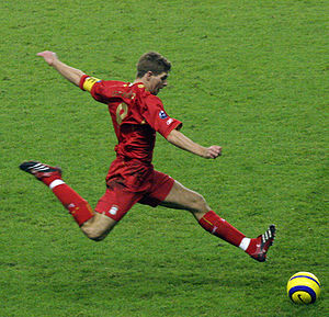 Professional sports - Liverpool Footballer Steven Gerrard preparing to strike the ball, 2005