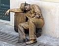 Living.statue.in.rome.arp.jpg
