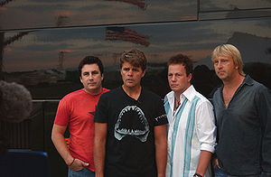 Lonestar pose for pictures before a show