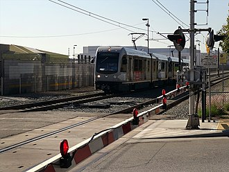 Gold Line (Los Angeles Metro) - Image: Los Angeles Metro Gold Line train crossing W Avenue 33 at Artesian St