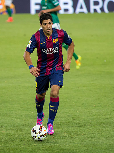 Suarez making his Barcelona debut against Club Leon in August 2014. After serving his four month suspension for biting at the 2014 World Cup he made his competitive debut for the club on 25 October. Luis Suarez FCB 2014.jpg