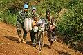Makilimbo, Haut Uélé, RD Congo- Des casques bleus aidant la population civile dans leurs activités quotidiennes à Makilimbo.jpg