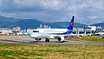 Mandarin Airlines Embraer 190 B-16822 Departing from Taipei Songshan Airport 20160731b.jpg