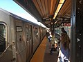 Manhattan bound N W Line platform at 30 Av.jpg