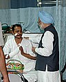 Manmohan Singh consoles Shri Harish Singh, an ITBP Security Guard of Indian Embassy, Kabul, who is recovering from fatal injuries inflicted recently in a bomb blast at Indian Embassy in Kabul.jpg