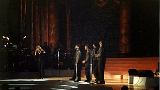 "Mariah Carey - Carey performing ""One Sweet Day"" alongside Boyz II Men, during a taping at Madison Square Garden in October 1995."