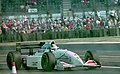 Mark Blundell - Tyrrell 022 leaves the pits at the 1994 British Grand Prix (32418592261).jpg