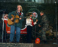 Mary Chapin Carpenter performs while Janet Langhart dances with a soldier.jpg