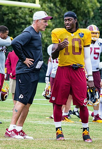 Position coach - Washington Redskins quarterback coach Matt Cavanaugh (left) with quarterback Robert Griffin III (right) in 2015