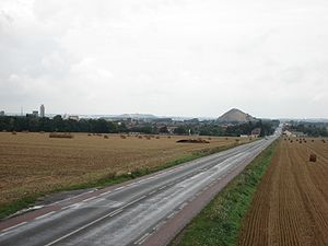Mazingarbe - Road to Lens with a slag heap in the background