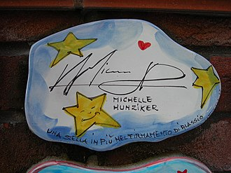 Michelle Hunziker - A tile of the wall of Alassio, (Italy), autographed by Michelle Hunziker