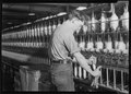 Millville, New Jersey - Textiles. Millville Manufacturing Co. (Man fixing machine.) - NARA - 518680.tif