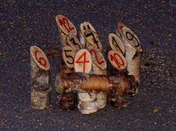 http://upload.wikimedia.org/wikipedia/commons/thumb/0/0a/Molkky.jpg/250px-Molkky.jpg