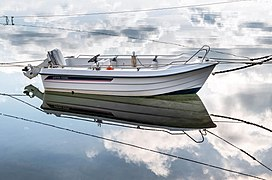 Motorboat Ryds 435DL and cloud reflections in Sämstad harbor 3.jpg