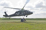Multinational soldiers learn sling load operations 130713-A-XD724-931.jpg