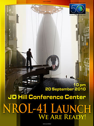 National Reconnaissance Office - Close-up of Atlas 501 payload fairing with NROL-41 satellite (poster commemorating 50 years of NRO).