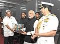 Narendra Modi being presented a memento by Manohar Parrikar at the International Fleet Review 2016.jpg