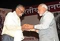 Narendra Modi presenting the 50th Jnanpeeth Award to Eminent Marathi littérateur Prof. Bhalchandra Nemade, at the 50th Jnanpeeth Award Ceremony, at Balayogi Auditorium, Parliament Library, in New Delhi on April 25, 2015.jpg