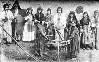 Urmia Plain - Nestorian (Assyrian) Christian family making butter in Urmia Plain (Mawana), Persia, date unknown
