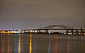 Newark Bay Bridge at night time.jpg