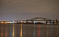 Newark Bay Bridge at night time.jpg