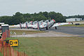 North American SNJ-4 Texans GEICO Skytypers Waiting SNF 04April2014 (14584492294).jpg