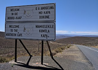 Northern Cape - Sign along R354 welcoming motorists into the Northern Cape from the Western Cape. The sign is in Afrikaans (top left), English (bottom left), Tswana (top right), and Xhosa (bottom right)