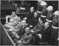 Nuremberg Trials. Defendants in their dock; Goering, Hess, von Ribbentrop, and Keitel in front row, circa 1945-1946., ca. 1945 - ca. 1946.tif