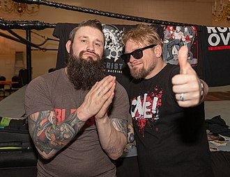 Ohio Versus Everything - Dave (left) and Jake Crist of Ohio Versus Everything posing post-show in February 2019