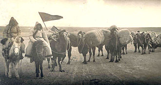 Mongolia - An image of an early 20th-century Oirat caravan, traveling on horseback, possibly to trade goods.