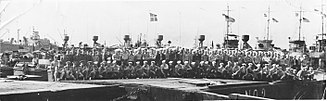 USS PGM-3 - Officers and crew of PGM Division One, Shanghai, China, October or November, 1945.  Six radar masts seen behind the men belong to the following ships: USS PGM-1, USS PGM-2, USS PGM-3, USS PGM-4, USS PGM-5, USS PGM-6