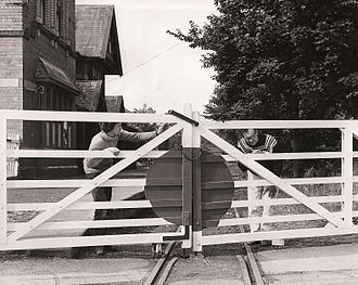Isle of Man Steam Railway Supporters' Association - Volunteers from the Supporters' Association repainting the crossing gates at Port St. Mary in July 1973