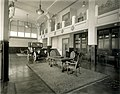 Packard Missouri Motor Company, 2201 Locust Street. Interior view of lobby with mezzanine, showing display automobile next to carpeted area with table and chairs.jpg