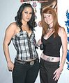 Paige Taylor, Nikki Coxxx at Evil Angel Party 2.jpg