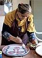 Painter Rini Dhumal at work.jpg
