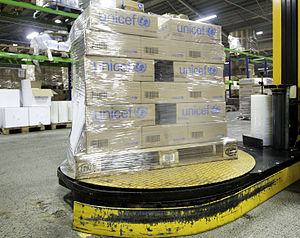 Stretch wrap - Pallet with corrugated fiberboard boxes being stretch wrapped