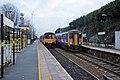Passing trains, Lea Green railway station (geograph 3818855).jpg
