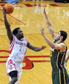 Patrick Beverley goes up for a shot against Enes Kanter (cropped2).jpg