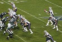 The Patriots lined up in front of Brady as he receives a snap