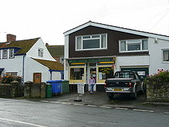 modern building with shop. Sign over window says Pawlett Country Store & Off Licence.