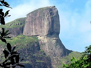 """Archaeological interest of Pedra da Gávea - Pedra da Gavea, Rio de Janeiro. The """"eyes"""" of the """"face"""" are looking towards the right-hand of this picture. The etchings that can be seen on the dome of the mountain make up the supposed inscription."""
